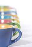 Colored coffee cups royalty free stock images