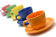 Colored coffee cups and dishes Royalty Free Stock Image