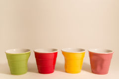 Colored coffee cups. Colored empty coffee cups withj white background Stock Photos