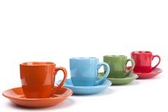 Colored Coffee Mugs Row Stock Photos