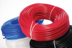 Colored coils of cable on a white background. Stock Photo