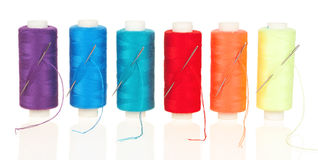 Colored coils with needles Stock Image