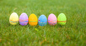 Colored colorful easter eggs in the grass Stock Photo