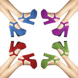 Colored composition shoes worn by female legs Royalty Free Stock Images