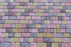 Colored concrete paving slab with a beautiful high-quality texture, close up Royalty Free Stock Photo