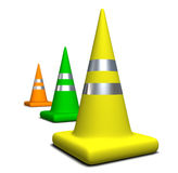 Colored Cones. Three colored traffic cones yellow, green and orange with steel strips standing on a white background Royalty Free Stock Images