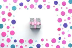 Colored confetti box gift on a white background. Top view flat lay royalty free stock image