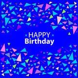 Colored confetti of triangles on a blue background Stock Photo