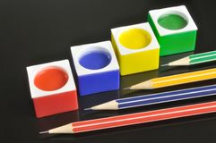 Colored containers of paint Stock Photos