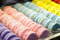 Colored cookies French macaroons series, variety. Royalty Free Stock Photos