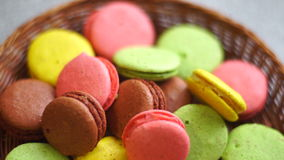 Colored cookies in the wicker plate stock video footage