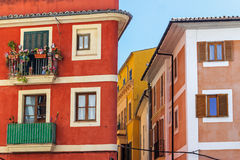 Colored corner facades with decorated balcony at Balearic Islands Stock Photo