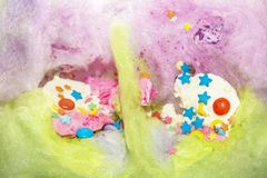 Colored cotton candy from sugar with ice cream and confetti of different shapes and color royalty free stock photo