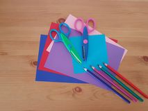 Arts and Crafts Supply, Kids Crafts, Back To School, School Supplies. Colored craft paper with colored pencils laying on a white background, Art teacher, Craft royalty free stock photo