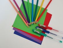 Arts and Crafts Supply, Kids Crafts, Back To School, School Supplies. Colored craft paper with colored pencils laying on a white background, Art teacher, Craft stock photography