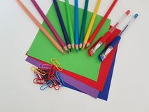 Arts and Crafts Supply, Kids Crafts, Back To School, School Supplies. Colored craft paper with colored pencils laying on a white background, Art teacher, Craft royalty free stock photos