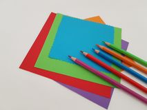 Arts and Crafts Supply, Kids Crafts, Back To School, School Supplies. Colored craft paper with colored pencils laying on a white background, Art teacher, Craft royalty free stock images