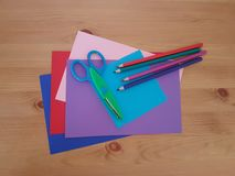 Arts and Crafts Supply, Kids Crafts, Back To School, School Supplies. Colored craft paper with colored pencils laying on a wooden background, Art teacher, Craft stock images