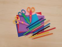Arts and Crafts Supply, Kids Crafts, Back To School, School Supplies. Colored craft paper with colored pencils laying on a wooden background, Art teacher, Craft royalty free stock photography