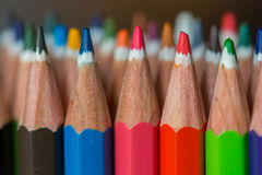 Colored crayon tips. On a dark background Stock Images