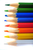 Colored crayons. Row with color pencils on white background Stock Images