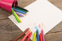 colored crayons and blank page on the wooden table Stock Photography