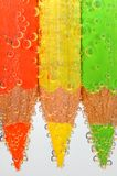 Colored crayons with bubbles royalty free stock photo