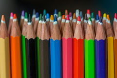 Colored crayons. Colored crayon tips on a blue background Royalty Free Stock Images