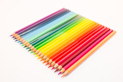 Colored crayons lying side by side Royalty Free Stock Image