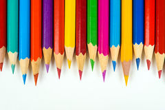 Colored crayons. Many colored pencils on a white background Royalty Free Stock Photography
