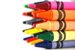 Colored Crayons. Rows of colorful wax crayons stock images