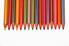 Colored crayons with text space on bottom. Vertical colored crayons. Tip down. Sharp pencils. Multicolored crayons flat lay  on white background. Space for text Stock Photo