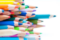 Colored crayons tops. Crayons bunch tops on white background stock image