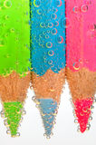 Colored crayons in water royalty free stock image