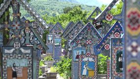 Colored crosses in Merry Cemetery, spring green nature, sapanta, romania