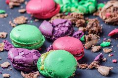 Colored Crumbed Macaroons on a black background, closeup. Crumbed Macaroons on black background, closeup, horizontal stock photo