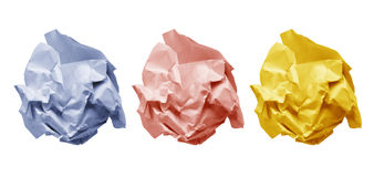 Colored crumple paper. Three colored crumple balls of paper isolated on white background Royalty Free Stock Photo