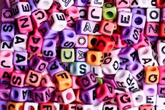 Colored cubes with English letters close-up royalty free stock photo
