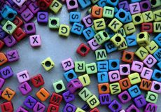 Colored cubes with letters. A number of colored cubes with letters Stock Image