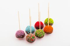 Colored cup cake on stick royalty free stock photography