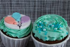 Colored cupcakes close-up on grey fabric background stock photo