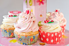 Colored cupcakes on a pink stand Stock Images