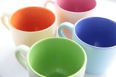 Colored cups Stock Images
