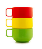 Colored cups. Isolated on a white background Royalty Free Stock Images