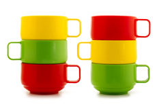 Colored cups. Isolated on a white background Royalty Free Stock Photo