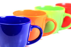 Colored cups. Beautiful shot of colored cups on white background Royalty Free Stock Photos