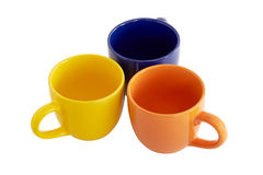 Colored cups. Isolated background. Stock Photos