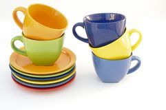 Colored cups and plates royalty free stock photo