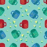 Colored cups with slogans and yellow hearts. Stock Photography