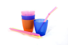 Colored cups and straws Stock Photo